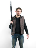 Brutal man with shotgun on white background Royalty Free Stock Photography