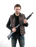 Brutal man with shotgun on white background.  Royalty Free Stock Photography