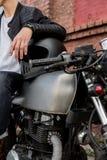 Brutal man sit on cafe racer custom motorbike. royalty free stock photo