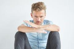 Brutal man sitting on the floor Stock Photo