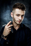 Brutal man with straight razor Royalty Free Stock Photos