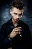 Brutal man with straight razor Stock Photos