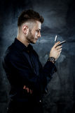 Brutal man with straight razor Royalty Free Stock Images