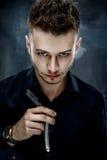 Brutal man with straight razor Stock Image