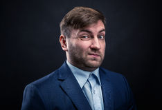Brutal man in suit on black background Royalty Free Stock Photos