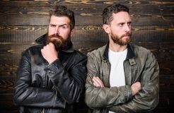 Brutal men wear leather jackets. Men brutal bearded hipster posing in fashionable black leather jackets. Leather fashion. Menswear. Handsome stylish and cool royalty free stock photo