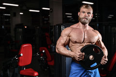 Brutal muscular man with beard unshaven fitness model healthcare. Brutal muscular man with beard train in the gym unshaven fitness model healthcare lifestyle Royalty Free Stock Images