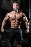 Brutal muscular man with beard unshaven fitness model healthcare Stock Photo