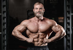 Brutal muscular man with beard unshaven fitness model healthcare Stock Image