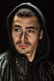 Brutal portrait of a young man in a hood. In the studio Royalty Free Stock Images