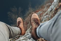 Mans shoes on hil of mountain Royalty Free Stock Photography