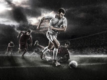 Brutal Soccer action on rainy 3d sport arena. mature player with ball royalty free stock photography