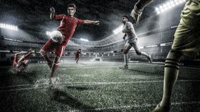 Brutal Soccer action on rainy 3d sport arena. mature player with ball stock photography