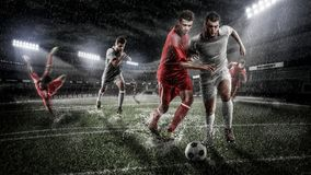 Brutal Soccer action on rainy 3d sport arena. mature player with ball. Brutal Soccer action on rainy 3d sport arena. mature players with ball Royalty Free Stock Image
