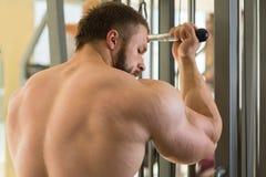 Brutal sportsman in gym. Stock Photo
