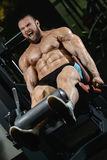 Brutal strong bodybuilder athletic men pumping up muscles with d Royalty Free Stock Images