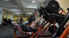 Brutal strong bodybuilder pumping up muscles, doing exercises in gym.  stock video