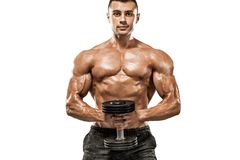 Brutal strong muscular bodybuilder athletic man pumping up muscles with dumbbell on white background. Workout stock photography