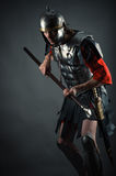 Brutal warrior in armor with a spear in hands Stock Photography