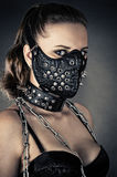 Brutal woman with mask spikes. Portrait of a brutal woman with mask spikes Stock Image