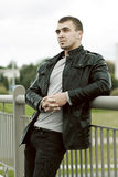 Brutal young man in a leather jacket Royalty Free Stock Photo