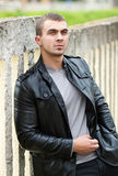 Brutal young man in a leather jacket Royalty Free Stock Photos