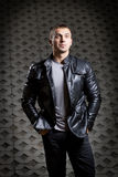 Brutal young man in a leather jacket Royalty Free Stock Photography