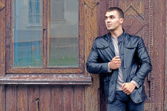 Brutal young man in a leather jacket Stock Photography