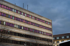 Brutalist building with lights reflecting off of windows Stock Photography