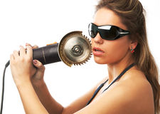 The brutality. Girl in sunglasses is holding circular saw near her cheek isolated on white Royalty Free Stock Photography