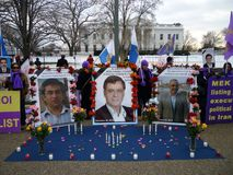 Brutality in Iran. Photo of protesters at the white house on 1/29/11 protesting executions of mek members by the iranian government.  The mek is a terror group Stock Photo