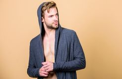 Brute masculinity extremely commanding looking conventionally handsome. Masculinity and confidence. Man muscular torso. Wear hooded clothes. Masculinity concept stock photos