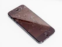 Bruten iPhone med den spruckna skärmen Royaltyfri Bild