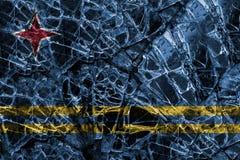 Bruten katastrof för fönsterexponeringsglas med att blanda den Aruba flaggan Royaltyfria Bilder