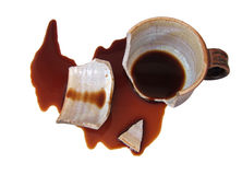Bruten kopp med spillt kaffe Arkivfoton
