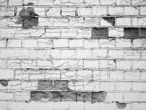 Bruten svartvit tegelstenvägg royaltyfri foto