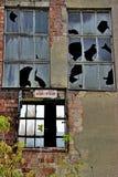 Brutna fönster Arkivbild