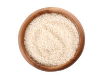 Brutna ris i en träbunke Royaltyfria Foton
