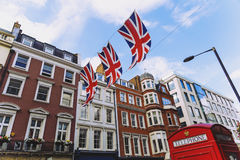 Bruton Street in the affluent area of Mayfair in London city centre. LONDON, UNITED KINGDOM - August 12th, 2016: Detail of Bruton Street in the affluent area of royalty free stock image