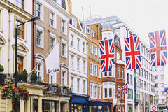 Bruton Street in the affluent area of Mayfair in London city cen. LONDON, UNITED KINGDOM - August 12th, 2016: Detail of Bruton Street in the affluent area of Royalty Free Stock Photography
