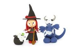 Bruxa e dragão Fotografia de Stock Royalty Free