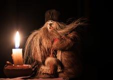 Bruxa e uma vela Fotos de Stock Royalty Free