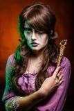 Bruxa e a varinha mágica Fotos de Stock