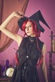 Bruxa em casa Imagens de Stock Royalty Free