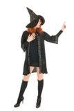 Bruxa má que aponta com dedo Foto de Stock