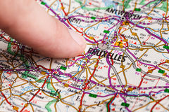 Bruxelles. Finger pointing at Bruxelles on a map stock photos