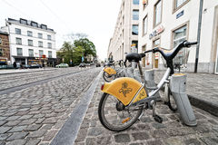 BRUXELLES - MAY 1, 2015: Public bike parking. Going by bike is a Stock Photography