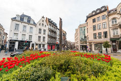 BRUXELLES - MAY 1, 2015: Tourists and locals along city streets. Stock Photos