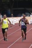Bryan Clay en Oleksyi Kasyanov bij tienkamp IAAF Stock Foto