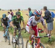 Bryan Nauleau Riding on a Cobblestone Road - Tour de France 2015 Royalty Free Stock Photos